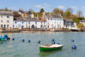 Dittisham waterfront row of traditional cottages line the edge of the river dart at in south devon england Stock Images