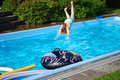Dive a smart into the pool in the garden Stock Images