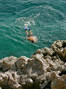 Diver and rock in the Adriatic Sea Stock Photos