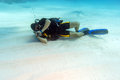 Diver sleeping on sandy sea bottom man Royalty Free Stock Photo