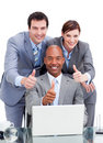 Diverse business co-workers with thums up Royalty Free Stock Photo