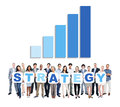 Diverse business people holding word strategy Stock Image