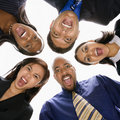 Diverse business people in huddle screaming. Stock Photography