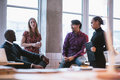 Diverse business team discussing work in office shot of creative young people new project Royalty Free Stock Photo