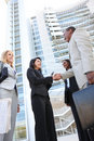 Diverse Business Team Handshake Stock Image