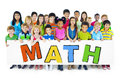 Diverse Cheerful Children Holding the Word Math Royalty Free Stock Photo