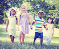 Diverse children friendship playing outdoors concept Stock Image