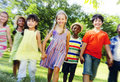 Diverse children friendship playing outdoors concept Stock Photos