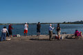 Diverse Collection of People Fishing from a Pier