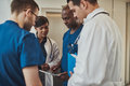 Diverse doctors having an emergency discussion Royalty Free Stock Photo