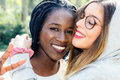 Diverse female couple showing affection. Royalty Free Stock Photo