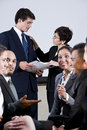 Diverse group of businesspeople conversing Stock Image