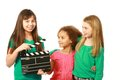 Diverse group of girl actors girls with one holding film slate Royalty Free Stock Images