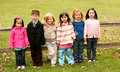 Diverse group of little kids outside Stock Image