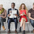 Diverse Group of People Community Togetherness Technology Sittin Royalty Free Stock Photo