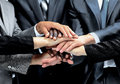 Diverse group of workers with their hands together in form teamwork Royalty Free Stock Photos
