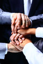 Diverse group of workers with their hands together in form teamwork Stock Photo