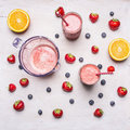 Diverse healthy fruits smoothies with colorful ingredients on white wooden background, top view. Superfoods healthy lifestyle Royalty Free Stock Photo