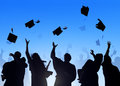 Diverse international students celebrating graduation Royalty Free Stock Image