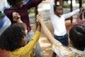 Diverse kindergarten students hands up together