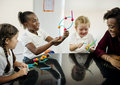 Diverse kindergarten students holding learning structures from t Royalty Free Stock Photo