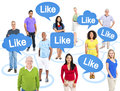 Diverse people and speech bubbles with word like cheerful multi ethnic group of standing individually above them the Stock Photo