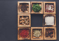 Diverse spices in a wooden box closeup
