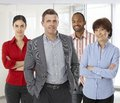 Diverse team of successful office people smiling workers boss and employees casual small business Stock Image
