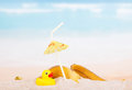 Diverse trash and rubber duck on  sea beach. Royalty Free Stock Photo