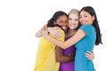 Diverse young women embracing each other on white background Royalty Free Stock Photo
