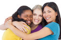 Diverse young women hugging each other on white background Stock Image