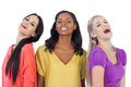 Diverse young women laughing at camera on white background Stock Images