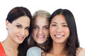 Diverse young women smiling at camera on white background Royalty Free Stock Photography