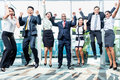 Diversity business team jumping celebrating success Royalty Free Stock Photo