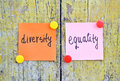 Diversity and equality stickers with words on wooden background Stock Photos