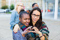 Diversity friends in city group of african asian and caucasian people Royalty Free Stock Image
