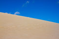 Divided photography on two part by sand and sky. Lands and panorama background. Sustainable ecosystem. Yellow dunes at Royalty Free Stock Photo