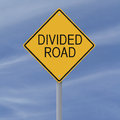 Divided road a sign indicating a Royalty Free Stock Photography