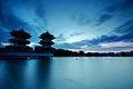 Divine chinese pagoda in blue evening lake Royalty Free Stock Image