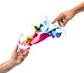 Divine creativity concept hands with color paint splash isolated on white Stock Photo