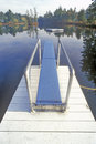 Diving board and pier at purity spring nh Stock Photo