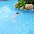 Diving in a swimming pool top view of young woman Royalty Free Stock Photo