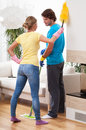 Division of household chores young happy couple Stock Photo