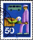 02 08 2020 Divnoe Stavropol Territory Russia the postage stamp Germany 1970 Voluntary Helpers Ambulance assistant man carries a Royalty Free Stock Photo