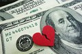 Divorce cash closeup of a broken red heart on concept Royalty Free Stock Images