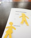 Divorce cutouts paper cutout man and woman on a document Royalty Free Stock Photos
