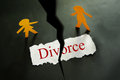 Divorce cutouts torn piece of paper with text and paper couple figures Stock Photos