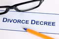 Divorce decree with black glasses and ballpoint pen Stock Images