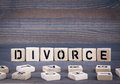 Divorce word written on wood block. Dark wood background with texture Royalty Free Stock Photo