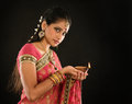 Diwali indian girl portrait of beautiful young woman in traditional sari dress holding oil lamp light isolated on black background Royalty Free Stock Photos